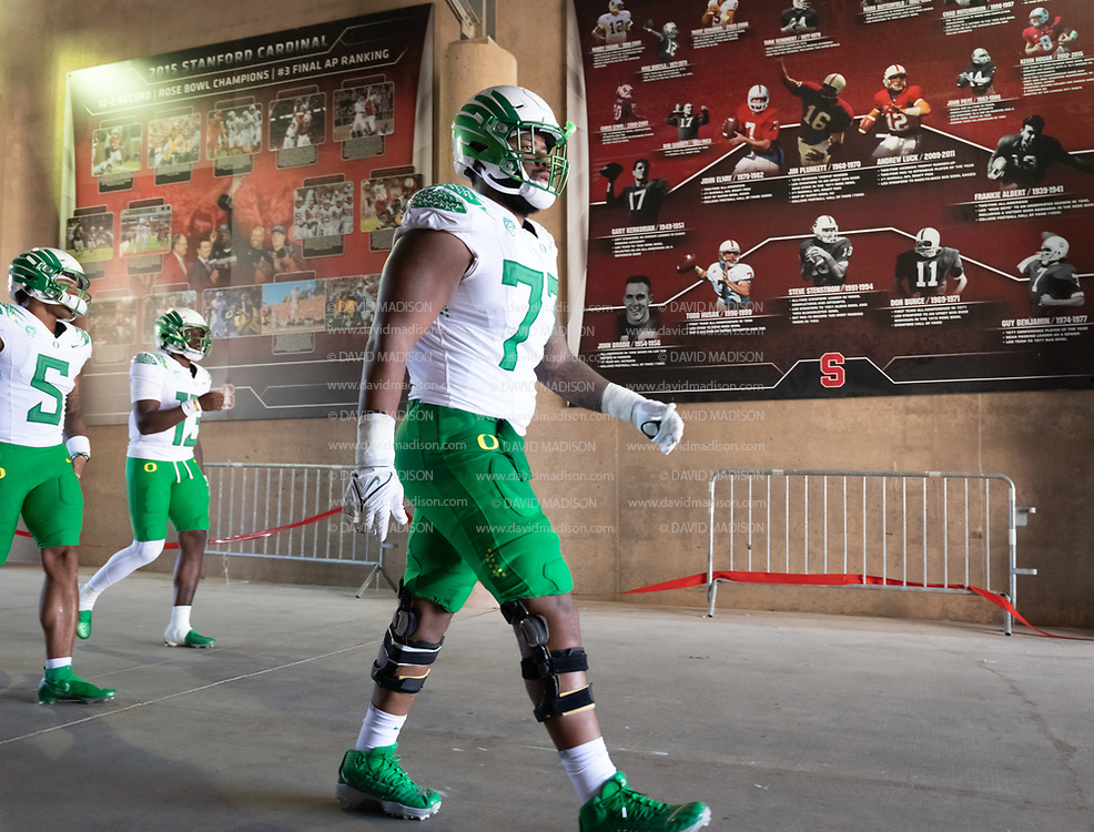 PALO ALTO, CA - OCTOBER 2:  George Moore #77 of the Oregon Ducks enters the stadium before the second half of an NCAA Pac-12 college football game against the Stanford Cardinal on October 2, 2021 at Stanford Stadium in Palo Alto, California.  (Photo by David Madison/Getty Images)