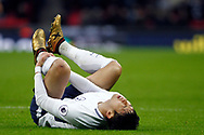 Son Heung-min of Tottenham Hotspur lies in pain after being tackled. Premier league match, Tottenham Hotspur v Stoke City at Wembley Stadium in London on Saturday 9th December 2017.<br /> pic by Steffan Bowen, Andrew Orchard sports photography.