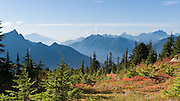 From atop Mount Dickerman, see South Fork Stillaguamish River Valley, Hall Peak (far left), Mount Pilchuck, and Three Fingers Mountain (6854 feet on far right). Mount Dickerman Trail #710 in Mount Baker-Snoqualmie National Forest starts from the Mountain Loop Highway east of Verlot, Washington, USA.