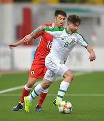 Gibraltar's Anthony Hernandez and Republic of Ireland's Sean Maguire (right) battle for the ball during the UEFA Euro 2020 Qualifying, Group D match at the Victoria Stadium, Gibraltar.