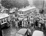 """Y-530605. New interurban trolleys at Oak Grove celebration.  Trolley #4019 & 4021. June 5, 1953. Caption published in Oregonian """"New cars on the interurban runs are actually 30 years old but are of steel construction and have more room. Here is ribbon-cutting ceremony at Oak Grove at celebration sponsored by organization of Oak Grove residents who fought traction company proposal to abandon interurban trolley service. Ceremony was conducted in rain."""""""