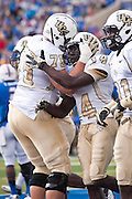 Dec 1, 2012; Tulsa, Ok, USA; University of Central Florida Knights offensive lineman Phil Smith (75) and wide receiver Quincy McDuffie (14) react to a play during a game against the Tulsa Hurricanes at Skelly Field at H.A. Chapman Stadium. Tulsa defeated UCF 33-27 in overtime to win the CUSA Championship. Mandatory Credit: Beth Hall-USA TODAY Sports