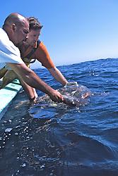 Rodrigo & J. Releasing Loggerhead Turtle