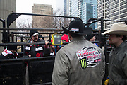 Professional Bull Riders Matt West and Matt Triplett observe a weigh-in of Special Olympics Illinois Athletes during a presentation with 2020 Professional Bull Riding (PBR) Tour and Special Olympics Illinois (SOILL) in Chicago, Friday, Jan. 10, 2020, in Chicago in Maggie Daley Park. (Max Siker/Image of Sport via AP)