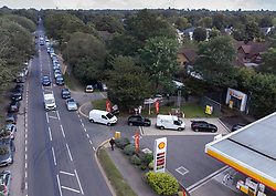 © Licensed to London News Pictures. 28/09/2021. Cobham, UK. A long queue forms at a Shell petrol station near Cobham in Surrey due to the current problems with the supply and distribution chain for fuel. The government have urged drivers not to panic buy fuel. Photo credit: Peter Macdiarmid/LNP