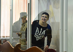 April 18, 2018 - Kyiv, Ukraine - MP Nadiya Savchenko stays in the glass-panelled security cage during a hearing at the Shevchenkivskyi District Court, Kyiv, capital of Ukraine, April 18, 2018. Ukrinform...KYIV. The Shevchenkivskyi District Court of Kyiv has held a hearing to consider a petition filed by the prosecutor which calls for a forced drawing of biological materials from MP Nadiya Savchenko. The lawmaker announced that she would consider any such action as a humiliation and torture. Later, the court dismissed the move. As reported, the Verkhovna Rada approved of Nadiya Savchenko's criminal prosecution, detention and arrest on March 22. The MP is suspected of actions aimed at enacting a coup, infringement on the life of a statesperson or civil activist, preparation of a terror act, facilitation of a terrorist organization and the illegal handling of weapons, ammunition and explosive substances. Moreover, Nadiya Savchenko and Volodymyr Ruban, the head of the Ofitserskyi Korpus (Officers' Corps) Centre for the Liberation of Captives who was also arrested, are suspected of preparing the assassination of President Petro Poroshenko. On March 23, the Shevchenkivskyi District Court ruled a two-month custodial detention without the right to bail for the people's deputy. During this hearing, the MP announced her hunger strike. On April 17, Nadiya Savchenko underwent a forensic psychological examination with the use of a polygraph. (Credit Image: © Olena Khudiakova/Ukrinform via ZUMA Wire)