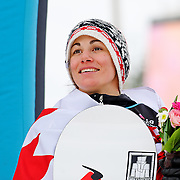 Maelle Ricker (CAN) celebrates her fourth place finish during the awards ceremony for the Ladies Snowboard-Cross event at the LG Snowboard World Cup held at Cypress Mountain, British Columbia on February 13th, 2009. Mandatory Photo Credit: Bella Faccie Sports Media\Thomas Di Nardo. Contact: Thomas Di Nardo, Snohomish, Washington, USA. Telephone 425-260-8467. e-mail: tom@bellafaccie.com