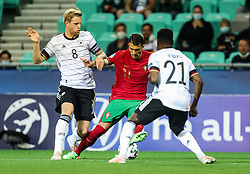 LJUBLJANA, SLOVENIA - JUNE 06: Dany Mota of Portugal vs Arne Maier of Germany and Ridle Baku of Germany during the 2021 UEFA European Under-21 Championship Final match between Germany and Portugal at Stadion Stozice on June 06, 2021 in Ljubljana, Slovenia. Photo by Grega Valancic / Sportida