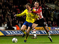 Photo: Richard Lane.<br />Southampton v Arsenal. Barclaycard Premiership.<br />29/12/2003.<br />Ray Parlour is challenged by Danny Higginbottom.