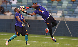 Itumeleng Khune G/K of Kaizer Chiefs gets out of the way of Brilliant Khuzwayo G/K of Kaizer Chiefs during the 2016 Premier Soccer League match between Kaizer Chiefs and Ajax Cape Town held at the Moses Mabhida Stadium in Durban, South Africa on the 24th September 2016<br /> <br /> Photo by:   Steve Haag / Real Time Images
