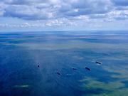 Nederland, Noord-Holland, Hollands Kroon; 07-05-2021; zicht op het IJsselmeer ter hoogte van de Afsluitdijk bij Den Oever. Werkschepen voor anker. Schaduwen van wolken op het water.<br /> Zicht op het IJsselmeer ter hoogte van de Afsluitdijk bij Den Oever. Werkschepen voor anker. Schaduwen van wolken op het water.<br /> <br /> luchtfoto (toeslag op standaard tarieven);<br /> aerial photo (additional fee required)<br /> copyright © 2021 foto/photo Siebe Swart