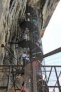 People  metal spiral staircase rock palace fortress, Sigiriya, Central Province, Sri Lanka, Asia