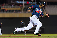 Eduardo Escobar #5 of the Minnesota Twins rounds 3rd base against the Miami Marlins in Game 2 of a split doubleheader on April 23, 2013 at Target Field in Minneapolis, Minnesota.  The Marlins defeated the Twins 8 to 5.  Photo: Ben Krause