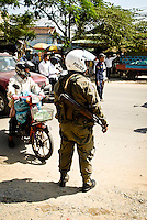A police traffic officer on the roadside in Phnom Penh, Cambodia