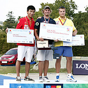 Brady ELLISON (USA) (C) and DAI Xiaoxiang (CHN) (L), Dmytro HRACHOV (UKR) (R) competes in Archery World Cup Final in Istanbul, Turkey, Sunday, September 25, 2011. (AP Photo/TURKPIX)