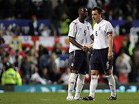 Photo: Paul Thomas.<br /> England v Macedonia. UEFA European Championships 2008 Qualifying. 07/10/2006.<br /> <br /> Dejected England captain John Terry (R) congratulates Man of the Match Ledley King after the match.
