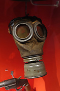 """Gas mask from the First World War. Scheduled to run through 2018 at York Castle Museum, the First World War Exhibition, """"1914: When the World Changed Forever"""" opened on 28 June 2014, exactly 100 years after Archduke Franz Ferdinand was assassinated, sparking a chain of events leading to war. York Castle Museum was founded in 1938 by Dr John Kirk, a doctor from Pickering, North Yorkshire. The museum houses Kirk's extraordinary collection of social history, reflecting everyday life in the county, including a fullscale Victorian reconstruction of Kirkgate street, a recreated Jacobean dining rooms (1567–1625), a history of children's toys, and exhibits on the First World War through the 1960s. The York Castle Museum is housed in a former debtors' prison (built in 1701–05 using stone from castle ruins) and in an adjoining former women's prison (built 1780–85) in North Yorkshire, England. Originally built by William the Conqueror in 1068, York Castle features a ruined keep now called """"Clifford's Tower."""""""