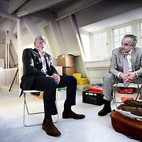 Nederland, Amsterdam , 14 januari 2010..Advocaten Ilan Spinath & Peter Wakkie (ex ahold topman) tussen de verhuisdozen..Foto:Jean-Pierre Jans