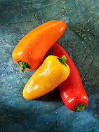 Mixed red, yellow & orange fresh mini peppers photos, pictures & images