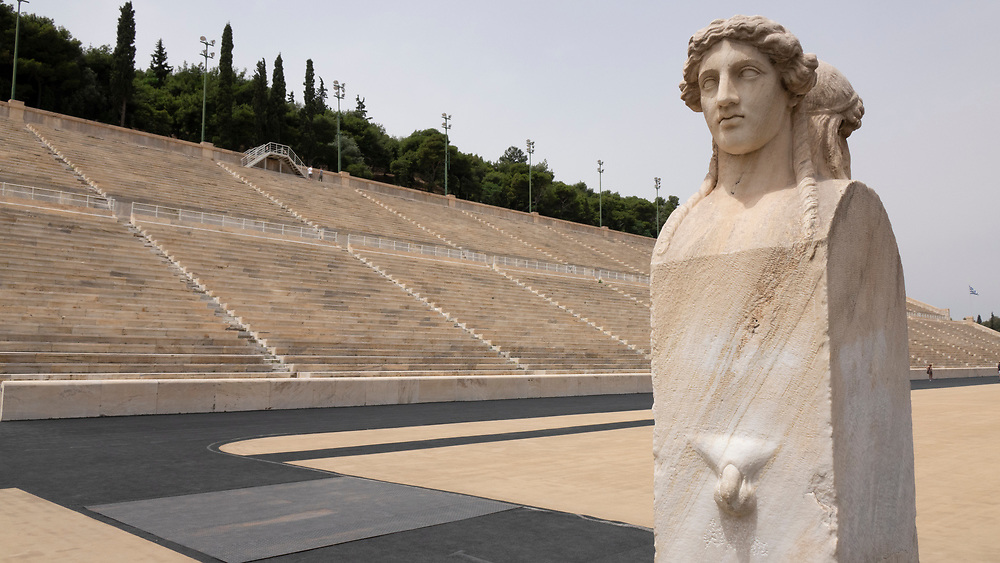 Double headed sculpture with phallus at the original Olympic Stadium in Athens, Greece<br /> A two side distinctive herms statue which depicts a young man on one side and and an older bearded man on the other side.