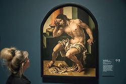 """© Licensed to London News Pictures. 28/02/2019. LONDON, UK. A visitor views """"Christ on the Cold Stone"""" c1530 by Jan Gossaert. Preview of """"The Renaissance Nude"""", an exhibition at the Royal Academy of Arts in Piccadilly of 90 works examining the emergence of the nude in European art.  Works by artists including Leonardo da Vinci to Michelangelo are on display in the Sackler Galleries 3 March to 2 June 2019.  Photo credit: Stephen Chung/LNP"""