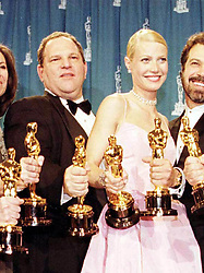 File photo dated 21/3/1999 of Harvey Weinstein and Gwyneth Paltrow after receiving the Oscars for their roles in the film Shakespeare In Love. Some of Hollywood's most powerful figures are due to discuss what action should be taken by the hosts of the Oscars against Weinstein.