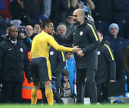 A smiling Alexis Sanchez of Arsenal with Josep Guardiola manager of Manchester City at the end of the match during the English Premier League match at the Etihad Stadium, Manchester. Picture date: December 18th, 2016. Picture credit should read: Simon Bellis/Sportimage