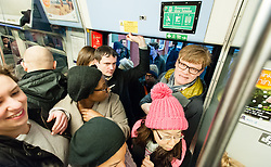 © Licensed to London News Pictures. 30/01/2015. London, UK. Commuters attempting to board a severely  overcrowded Thameslink cross London service during Friday morning rush hour, travelling into Central London.  Thames link are running a reduced carriage service as a result of flooding between Farringdon and St Pancras International due to a burst water main.. Photo credit : Richard Isaac/LNP