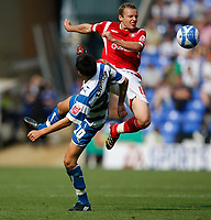 Photo: Steve Bond/Richard Lane Photography. Reading v Nottingham Forest. Coca Cola Championship. 08/08/2009. Jem Karacan (front) loses out as Paul McKenna (Back) clears