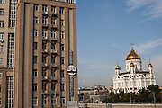 Moscow Russia, 31/07/2011..The House On The Embankment and the Cathedral of Christ the Saviour, two of the locations used by Mikhail Bulgakov in his novel The Master And Margarita.