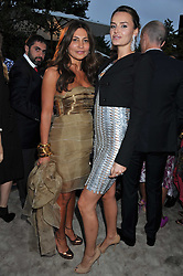 Left to right, ELLA KRASNER and MASHA MARKOVA at the annual Serpentine Gallery Summer Party sponsored by Burberry held at the Serpentine Gallery, Kensington Gardens, London on 28th June 2011.