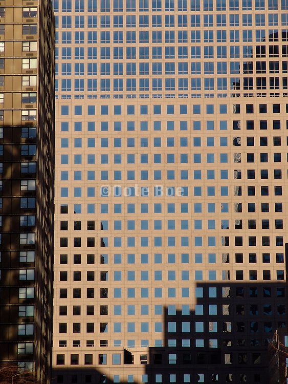 Close up of an office high rise and a residential high-rise.