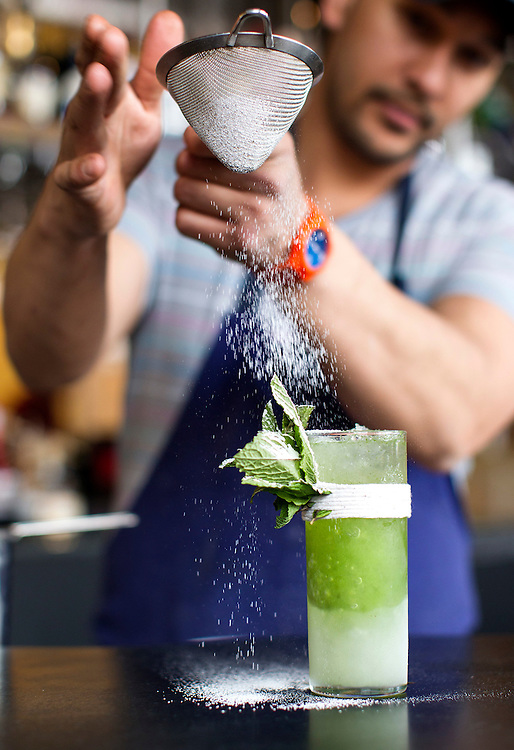 Owner Bob Gerken sifts powdered sugar on a mojito at Travail and the Rookery in Robbinsdale April 18, 2014.