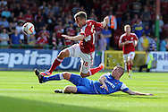 Orient's Ben Chorley tackles Swindon's Andy Williams (16). NPower league one, Swindon Town v Leyton Orient at the County Ground in Swindon on Saturday 8th Sept 2012.  pic by  Andrew Orchard, Andrew Orchard sports photography,