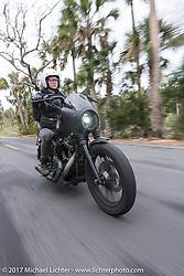 Iron Lilly Kristen Lassen riding a Harley-Davidson Sportster through Tomoka State Park during Daytona Beach Bike Week. FL. USA. Tuesday, March 14, 2017. Photography ©2017 Michael Lichter.