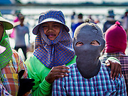 20 FEBRUARY 2019 - BAN LAEM, PHETCHABURI, THAILAND: Salt workers on one of the first days of the 2019 salt harvest in Ban Laem, Thailand. The workers cover their faces to protect them from the sun. Ban Laem's salt fields are expanding because salt harvesters in Samut Sakhon and Samut Songkhram,  which are closer to Bangkok, are moving to Ban Laem as their land is turned into industrial parks.      PHOTO BY JACK KURTZ