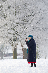© under license to London News Pictures.  19/12/2010 A woman takes pictures of the freshly fallen snow in Pershore today (19/12/2010). Temperatures plummeted to minus 19 last night, making it one of the coldest places in England.  Picture credit should read: David Hedges/LNP
