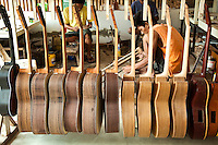 Guitar Makers at Alegre, Mactan Cebu - Though pre-colonial Visayans had a variety of string instruments which used a coconut shell or gourd as resonator - the guitar is a Spanish introduction. Guitars have been made in Cebu since the Spanish period. Guitar making in Cebu passes from generation to generation.