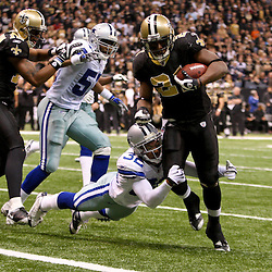2009 December 19:  New Orleans Saints running back Mike Bell (21) runs past Dallas Cowboys cornerback Orlando Scandrick (32) for a touchdown in the fourth quarter during a 24-17 win by the Dallas Cowboys over the New Orleans Saints at the Louisiana Superdome in New Orleans, Louisiana.