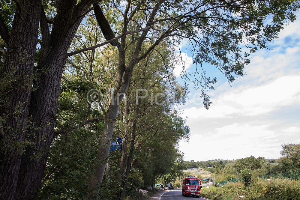 A hammock is suspended between trees alongside Harvil Road which environmental activists are seeking to protect from felling for the HS2 high-speed rail link on 29th July 2020 in Harefield, United Kingdom. Activists based at a series of wildlife protection camps have been attempting to disrupt the removal of many thousands of trees in the Colne Valley for the high-speed rail project.