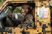 """Mcc0081437 . Daily Telegraph<br /> <br /> DT Foreign<br /> <br /> Yemeni militia loyal to Marib's provincial governor, Sultan Al-Aradah driving through Marib .<br /> Thanks to oil revenues and close ties with Saudi Arabia Marib could be viewed almost as an oasis of normalcy in a country torn apart by civil war . Since the conflict began in 2015 the town has expanded dramatically with Yemeni's flooding in from Houthi controlled areas attracted by the relative peace and stability .<br /> <br /> Yemen has been in the midst of a civil war since 2015 when the President Abdrabbuh Mansur Hadi was forced to flee . A Saudi led coalition with 9 other Arab states  named """"Operation Decisive Storm """"  has since sought to restore Hadi with little effect .<br /> <br /> Yemen 20 February"""