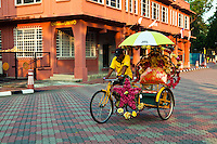 Taking a trishaw ride through Melaka seems to be the thing to do for every visitor. ;There are dozens of them offering this service and the price is fixed these days at 40 Malaysian Ringgit per hour. Unlike other towns where richsaws still ply the streets, the fixed rate ensure a reasonable fare for passengers and an equitable income for the driver. The trishaws in Melaka are colorful with lots of decorations, each with their own individual design. The rickshaws add to the color of Melaka.