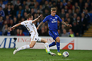 Danny Ward of Cardiff city ® goes past a tackle from Matthew Pennington of Leeds Utd. EFL Skybet championship match, Cardiff city v Leeds Utd at the Cardiff city stadium in Cardiff, South Wales on Tuesday 26th September 2017.<br /> pic by Andrew Orchard, Andrew Orchard sports photography.
