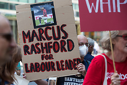 London, UK. 20th July, 2021. A man holds a sign calling for footballer Marcus Rashford to lead the Labour Party at a protest lobby outside the party's headquarters by supporters of left-wing groups. The lobby was organised to coincide with a Labour Party National Executive Committee meeting during which it was asked to proscribe four organisations, Resist, Labour Against the Witchhunt, Labour In Exile and Socialist Appeal, members of which could then be automatically expelled from the Labour Party.