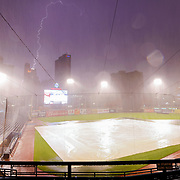 The Toledo Mud Hens and Columbus Clippers game is called in the eighth inning due to inclement weather as rain pours and lightning strikes at Fifth Third Field in Toledo on Tuesday, Sept. 14, 2021. THE BLADE/KURT STEISS