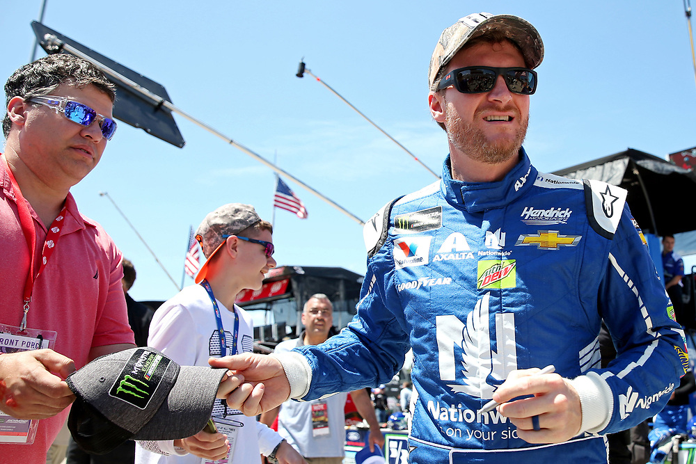 Apr 30, 2017; Richmond, VA, USA; NASCAR Cup Series driver Dale Earnhardt Jr. (88) signs autographs before the Toyota Owners 400 at Richmond International Raceway. Mandatory Credit: Peter Casey-USA TODAY Sports