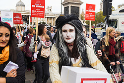 """London, October 31 2017. PICTURED: A woman carries a box containing a petition with 82,965 signatures to be delivered to MPs. Working mothers' rights group Pregnant Then Screwed holds a March of the Mummies demonstration, marching from Trafalgar Square to Parliament Square, demanding """"recognition, respect and change for working mums"""". © Paul Davey"""