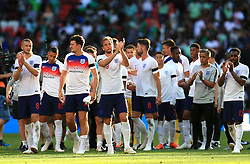 England's Harry Kane (centre) applauds the fans after the final whistle with team-mates