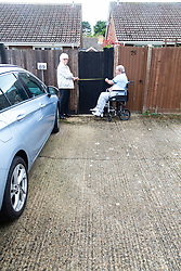 Annette and Raymond Timmins' demonstrate the 76cm width of a disputed piece of land in the car park, the battleground with the owner of a neighbouring property Maidenhead, September 12 2018.