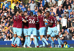 West Ham United's Andriy Yarmolenko (centre) celebrates scoring his side's second goal of the game with team mates during the Premier League match at Goodison Park, Liverpool.